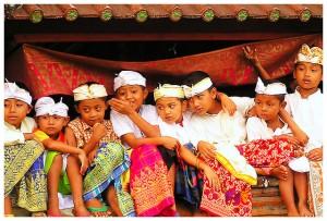 Balinese children watching religious ceremony